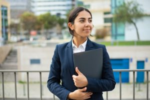 happy-businesswoman-holding-folder_74855-5075