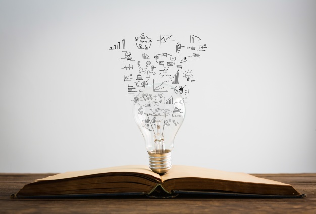 symbols-come-out-bulb-top-book_1232-908